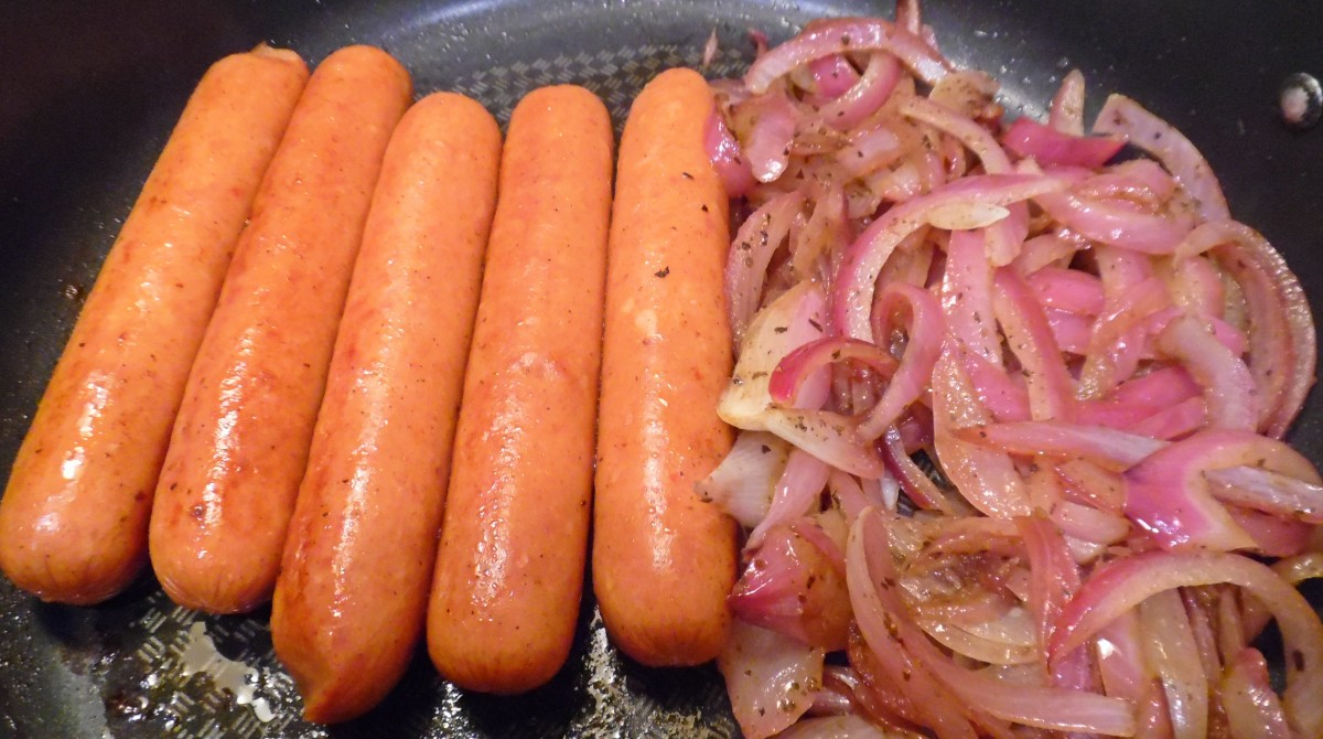 Bahama Mama Sausages Grilled Onions And Pickled Cabbage